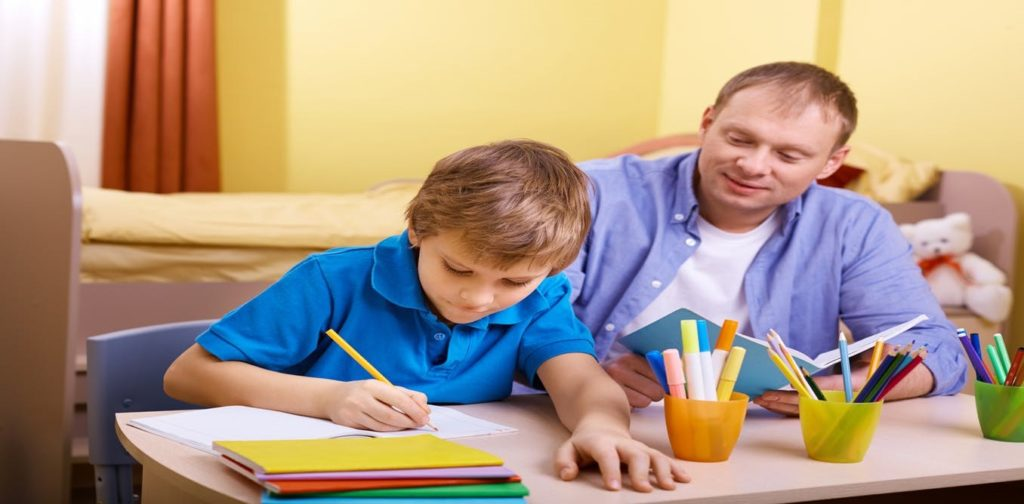 dad and son home schooling